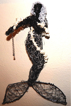 """Black and White Mermaid"".  The torso and underlying metal frame is painted; the tail and texture areas (black and white) are made with the filament."